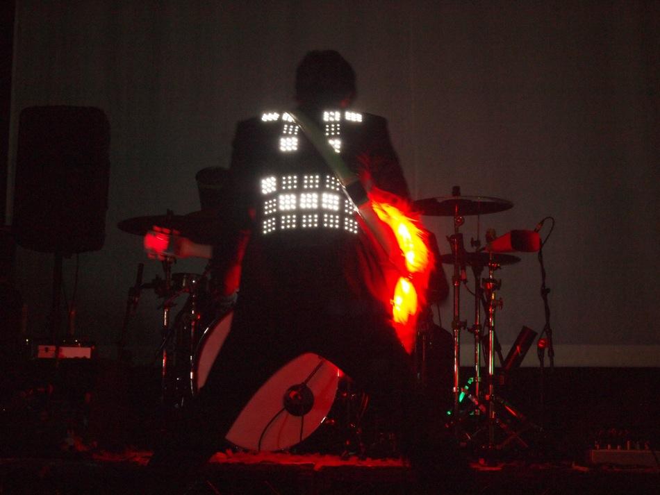 Damian Kulash with LED jacket and Fendi guitar